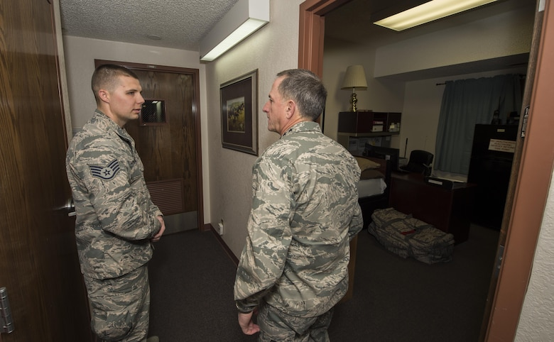 Staff Sgt. Kurtis Wimberly, 319th Missile Squadron facility manager, provides a tour of the missile alert facility to Air Force Chief of Staff Gen. David L. Goldfein during a familiarization tour at a missile alert facility in the 90th Missile Wing missile complex, Dec. 19, 2016. This was Goldfein's first visit to an ICBM wing as the CSAF. (U.S. Air Force photo by Staff Sgt. Christopher Ruano)