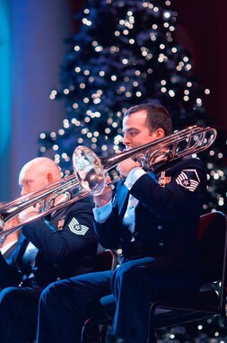 Trombonist Master Sgt David Rosengaft performs with the Concert Band's brass section during the 2016 Spirit of the Season concert at DAR's Constitution Hall. (US Air Force Photo by Chief Master Sgt Bob Kamholz/released)