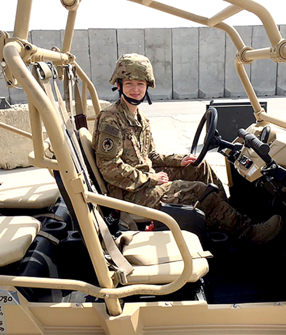 Airman 1st Class Corynn Marcelo sits in one the MRZR military vehicles used by the medical team. Marcelo was deployed to Camp Vance for five-and-a-half months as a medical logistician from Robins Air Force Base, Ga. (Courtesy photo)