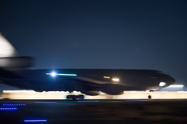 A KC-10 Extender launches from a runway at an undisclosed location in Southwest Asia, Dec. 15, 2016. Five minutes before this launch, maintenance crews fled the runway to a safe zone. Maintenance crews worked for 15 days removing excessive build up on the runway. The strategic operation successfully enabled the 380th Air Expeditionary Wing to maintain its current level of support in Combined Joint Task Force-Operation Inherent Resolve. (U.S. Air Force photo/Senior Airman Tyler Woodward)