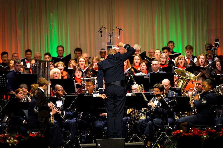 The U.S. Air Forces Europe Band, along with German and American choirs, performs a Christmas concert at Kaiserslautern, Germany, Dec. 16, 2016. The event took place to continue to strengthen social bonds between the U.S. military community and local community. (U.S. Air Force photo by Airman 1st Class Joshua Magbanua)