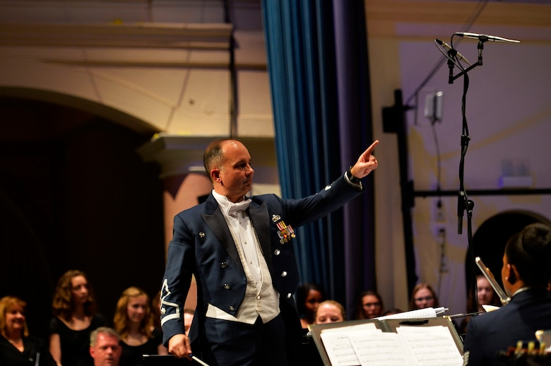 Lt. Col. Donald E. Schofield, U.S. Air Forces Europe Band conductor, conducts the USAFE Band's Christmas performance at Kaiserslautern, Germany, Dec. 16, 2016. The performance featured not only the USAFE Band, but also German and American choirs. (U.S. Air Force photo by Airman 1st Class Joshua Magbanua)