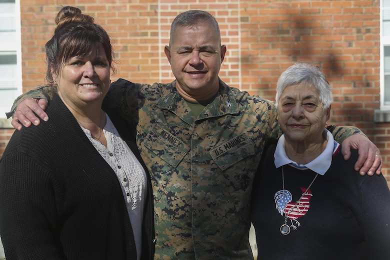 Col. Jeffrey J. Kenney, center, poses for a photo with his wife Lori Kenney, left, and mother Carmela Kenney, right, at Camp Lejeune, N.C., Nov. 8, 2016. Kenney has served in the Marine Corps for 41 years and is scheduled to retire Dec. 21, 2016. Kenney is currently the officer-in-charge of Expeditionary Operations Training Group, II Marine Expeditionary Force Headquarters Group. (U.S. Marine Corps photo by Sgt. Lucas Hopkins)