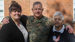 Col. Jeffrey J. Kenney, center, poses for a photo with his wife Lori Kenney, left, and mother Carmela Kenney, right, at Marine Corps Base Camp Lejeune, N.C., Nov. 8, 2016. Kenney has served in the Marine Corps for 41 years and is scheduled to retire Dec. 21, 2016. Kenney is currently the officer-in-charge of Expeditionary Operations Training Group, II Marine Expeditionary Force Headquarters Group.