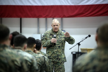 General Robert Neller, the commandant of the Marine Corps, speaks to Marines at Naval Air Station Sigonella, Italy, Dec. 20, 2016. Gen. Neller and Sgt. Maj. Ronald L. Green, the sergeant major of the Marine Corps, stopped by to visit the Marines of Special Purpose Marine Air-Ground Task Force Crisis Response-Africa during a trip to spend time with troops during the holiday season.  (U.S. Marine Corps photo by Cpl. Alexander Mitchell/released)