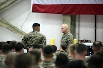 Cpl. Marcoantonio Gonzalez, a personnel administrative specialist asks General Robert Neller, the commandant of the Marine Corps, a question about new physical fitness standards at Naval Air Station Sigonella, Italy, Dec. 20, 2016. Gen. Neller and Sgt. Maj. Ronald L. Green, the sergeant major of the Marine Corps, stopped by to visit the Marines of Special Purpose Marine Air-Ground Task Force Crisis Response-Africa during a trip to spend time with troops during the holiday season.  (U.S. Marine Corps photo by Cpl. Alexander Mitchell/released)