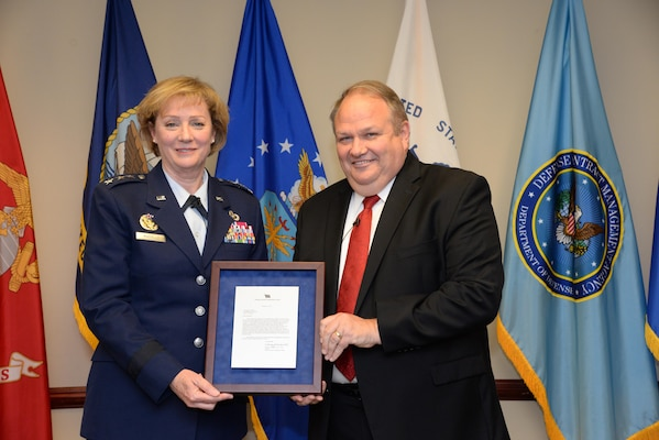 Air Force Lt. Gen. Wendy Masiello, Defense Contract Management Agency director, recognizes Jim Russell, her deputy, at a Dec. 19 retirement ceremony at Fort Lee, Virginia. Russell retired after 36 years of federal service, mostly with DCMA or its predecessor organizations. (DCMA photo by Stephen Hickok)