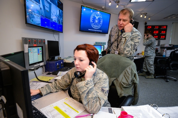 Emergency actions controllers Airman 1st Class Meggan Van Atta, Master Sgt. Jeremy Smith, and Senior Airman Jeremy Odneal answer response calls in the Hill Command Post, Nov. 18, 2016. Command post specialists ensure base operations and communications run efficiently and effectively under any circumstance by providing command, control, communications and information support. (U.S. Air Force photo by R. Nial Bradshaw)