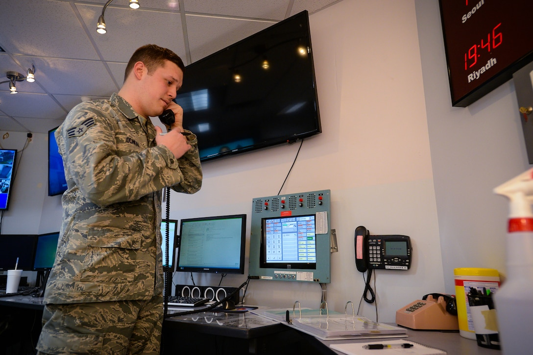 Emergency Actions Controller Senior Airman Jeremy Odneal answers a response call in the command post at Hill Air Force Base, Utah, Nov. 18, 2016. The command post is manned at all times by two certified emergency actions controllers. Both active-duty and Reserve Airmen operate the Hill Command Post. (U.S. Air Force photo by R. Nial Bradshaw)