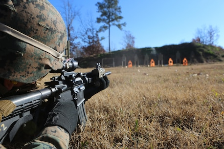 Lance Cpl. Navarro J. Merriman engages targets during a deployment for training exercise at Fort Pickett, Va., Dec. 3, 2016. The Marines conducted an urban-assault course in order to become tactically and technically proficient while operating in an urban environment. Merriman is a field radio operator assigned to 3rd Battalion, 8th Marine Regiment, 2nd Marine Division. (U.S. Marine Corps photo by Cpl. Shannon Kroening)