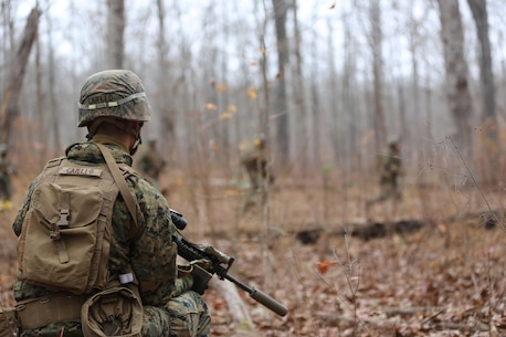 Pfc. Jacob T. Caiello looks on as Marines perform a movement-to-contact drill during a deployment for training exercise at Fort Pickett, Va., Dec. 4, 2016. The range was designed for Marines to prepare for their upcoming deployment to Okinawa, Japan. Caiello is a rifleman with 3rd Battalion, 8th Marine Regiment, 2nd Marine Division. (U.S. Marine Corps photo by Cpl. Shannon Kroening)