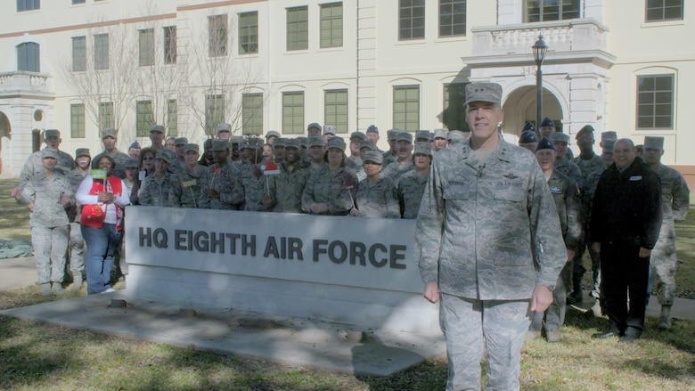 U.S. Air Force Maj. Gen. Thomas Bussiere, Eighth Air Force commander, along with members of the 608th Air Operations Center and Eighth Air Force staff deliver a holiday greeting with KSLA-TV (ABC) for the local Shreveport and Bossier City, LA communities Dec. 19, 2016. (U.S. Air Force photo by SrA Gabriel Stuart)