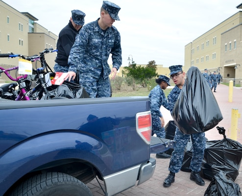 Students load toys into a truck outside of Anderson Hall at the Medical Education and Training Campus, or METC, at Joint Base San Antonio-Fort Sam Houston, wrapping up METC's fifth annual toy drive. Anderson Hall was named after Petty Officer 3rd Class Christopher Anderson who was killed in action Dec. 4, 2006 in Ramadi, Iraq, while serving with the 1st Battalion, 6th Marines. Every year, Sailors at METC organize a toy drive in Anderson's honor to collect donations for Toys for Tots.