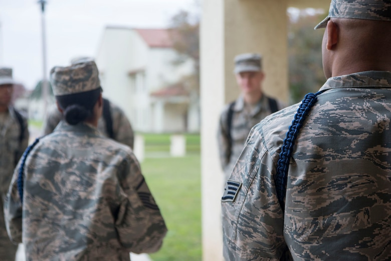 Master Sgt. Kelli Jackson (left), 558th Flying Training Squadron military training leader and superintendent, and Derius Jackson, 558th FTS military training leader and assistant flight chief, conduct morning formation with basic sensor operator technical training students at Joint Base San Antonio-Randolph Dec. 14, 2016. To become an MTL, a special duty, service members must be recommended by their leadership and graduate from a Military Training Leader Course at Keesler Air Force Base, Miss. (U.S. Air Force photo by Airman 1st Class Lauren Parsons/Released)