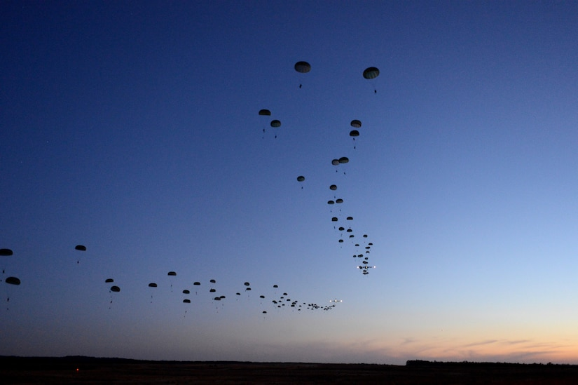 Soldiers from the 1st Battalion, 508th Parachute Infantry Regiment, conduct a static-line airdrop from an Air Force C-17 Globemaster III aircraft during Joint Operational Access Exercise 13-02 at Sicily drop zone, Fort Bragg, N.C., Feb. 24, 2013. The JOAX exercises are a combined exercises that enables U.S. and Canadian mobility aircrews to train with paratroopers from the Army's 82nd Airborne Division on projecting combat power in a denied environment -- one of the future-war challenges areas that spurred the department to launch the recent Operational Challenges Crowdsourcing Initiative. Air Force photo by Tech. Sgt. Jason Robertson