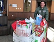 Master Sgt. James Courneya, 934th Operations Group, delivers a load of gifts at the Minnesota Veteran's Home Dec. 15.