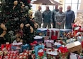 From left, Senior Master Sgt. Andy Regal, Capt. William-Joseph Mojica, Master Sgt. James Courneya, Senior Airman Jenny Delzer and rick Pelzl stand with the gifts delivered to the Minnesota Veteran's Home Dec. 1.