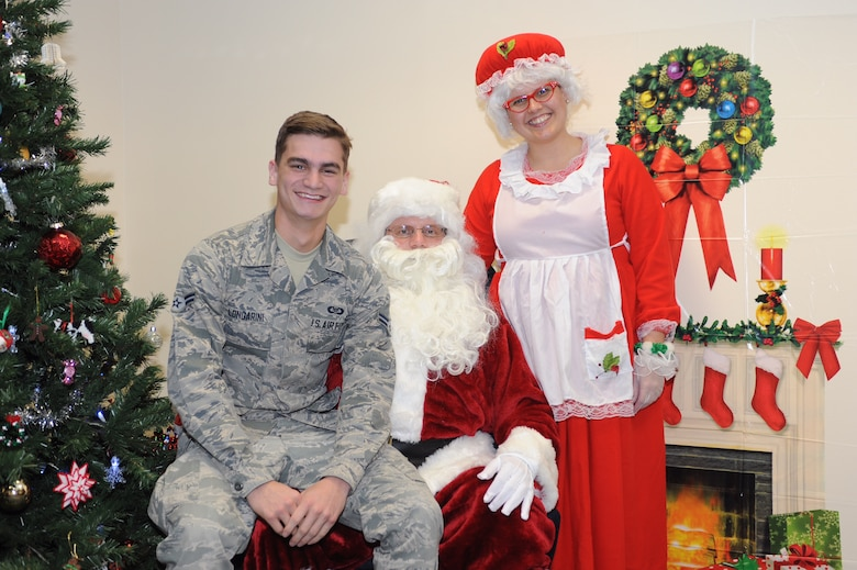 Senior Airman Ricardo Longarini, 92nd Air Refueling Squadron aviation resource manager, celebrates the holiday season with Santa and Mrs. Claus Dec. 14, 2015, at Incirlik Air Base, Turkey. Longarini spent more than four months at Incirlik assisting in setting up the 22nd Expeditionary Air Refueling Squadron. (Courtesy Photo)