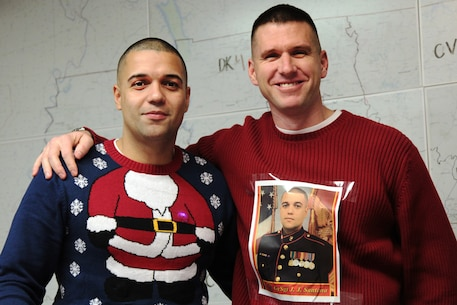 In the spirit of the holiday season, Gunnery Sgt. Jorge Santana (left) and Maj. Jonathan Landers pose for a photo together for the ugliest sweater contest during Recruiting Station Tennessee's Christmas party on Dec. 19, 2016, in Nashville, Tennessee. Santana is the assistant recruiting instructor and Landers is the commanding officer of Recruiting Station Tennessee. (Official Marine Corps photo by Sgt. Michael Iams/Released)