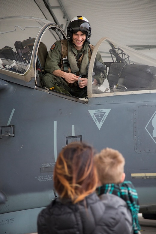Maj. Matthew Martinez is welcomed by his family during a homecoming at Marine Corps Air Station Cherry Point, N.C., Dec. 19, 2016. A detachment of Marines from Marine Attack Squadron 542, Marine Aircraft Group 14, 2nd Marine Aircraft Wing, were attached to Marine Medium Tiltrotor Squadron 264 (Reinforced), Marine Aircraft Group 26, 2nd MAW, 22nd Marine Expeditionary Unit. The 22nd MEU, deployed with the Wasp Amphibious Ready Group, conducted naval operations in support of U.S. national security interests in Europe.Martinez is an AV-8B Harrier II pilot assigned to VMA-542. (U.S. Marine Corps photo by Sgt. N.W. Huertas/ Released)