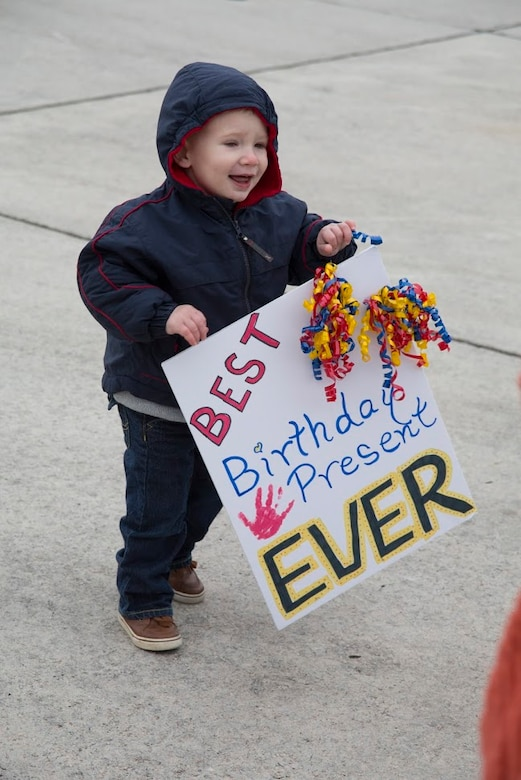 Maj. Nicholas Tyson's son, William, eagerly awaits the return of his father during a homecoming event aboard Marine Corps Air Station Cherry Point, N.C., Dec. 19, 2016. A detachment of Marines assigned to Marine Attack Squadron 542, Marine Aircraft Group 14, 2nd Marine Aircraft Wing were attached to Marine Medium Tiltrotor Squadron 264 (Reinforced), 22nd Marine Expeditionary Unit. The 22nd MEU, deployed with the Wasp Amphibious Ready Group, conducted naval operations in support of U.S. national security interests in Europe. Tyson is an AV-8B Harrier II pilot assigned to VMA-542. (U.S. Marine Corps photo by Sgt. N.W. Huertas/ Released)