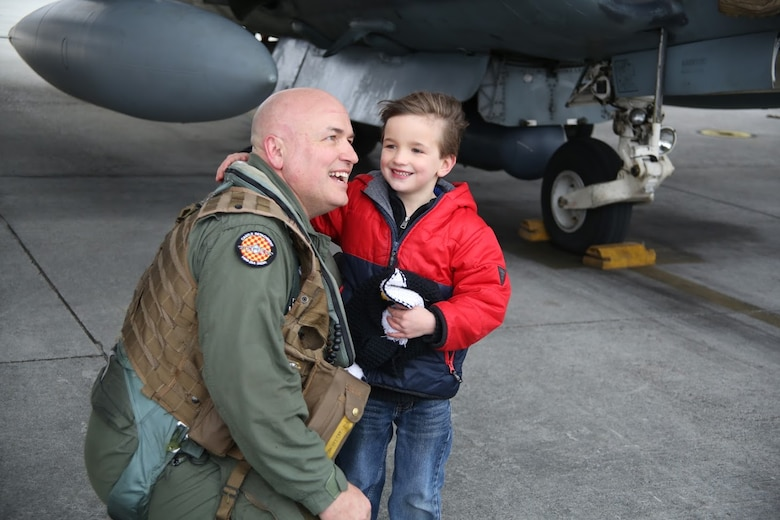 Lt. Col. Joseph Beals is greeted by his son Mason during a homecoming at Marine Corps Air Station Cherry Point, N.C., Dec. 19, 2016. A detachment of Marines from Marine Attack Squadron 542, Marine Aircraft Group 14, 2nd Marine Aircraft Wing, were attached to Marine Medium Tiltrotor Squadron 264 (Reinforced), Marine Aircraft Group 26, 2nd MAW, 22nd Marine Expeditionary Unit. The 22nd MEU, deployed with the Wasp Amphibious Ready Group, conducted naval operations in support of U.S. national security interests in Europe. Beals is the executive officer of VMA-542. (U.S. Marine Corps photo by Sgt. N.W. Huertas/ Released)