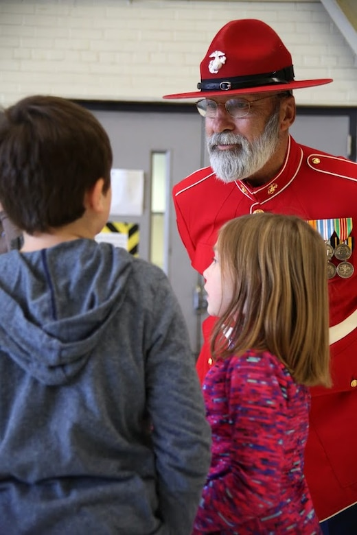 Gunny Claus meets children during a homecoming at Marine Corps Air Station Cherry Point, N.C., Dec. 20, 2016. A detachment of Marines from Marine Attack Squadron 542, Marine Aircraft Group 14, 2nd Marine Aircraft Wing, were attached to Marine Medium Tiltrotor Squadron 264 (Reinforced), Marine Aircraft Group 26, 2nd MAW, 22nd Marine Expeditionary Unit. The 22nd MEU, deployed with the Wasp Amphibious Ready Group, conducted naval operations in support of U.S. national security interests in Europe. (U.S. Marine Corps photo by Sgt. N.W. Huertas/ Released)