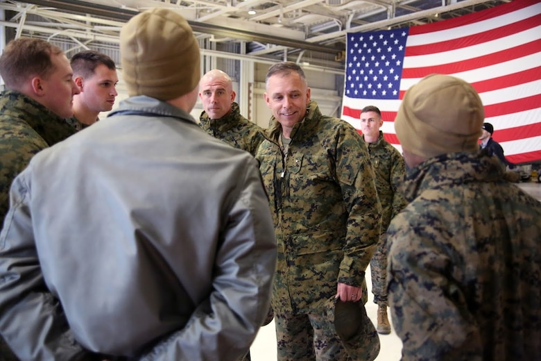 Sgt. Maj. Howard Kreamer, center, and Brig. Gen. Matthew Glavy greet Marines during a homecoming at Marine Corps Air Station Cherry Point, N.C., Dec. 19, 2016. A detachment of Marines from Marine Attack Squadron 542, Marine Aircraft Group 14, 2nd Marine Aircraft Wing, were attached to Marine Medium Tiltrotor Squadron 264 (Reinforced), Marine Aircraft Group 26, 2nd MAW, 22nd Marine Expeditionary Unit. The 22nd MEU, deployed with the Wasp Amphibious Ready Group, conducted naval operations in support of U.S. national security interests in Europe.Glavy is the commanding general of 2nd MAW and Kreamer is the sergeant major of 2nd MAW.  (U.S. Marine Corps photo by Sgt. N.W. Huertas/ Released)