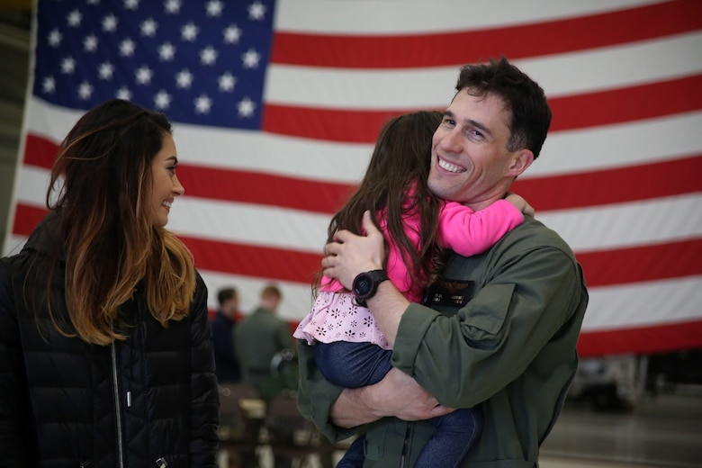 Maj. Matthew Martinez is welcomed by his family during a homecoming at Marine Corps Air Station Cherry Point, N.C., Dec. 19, 2016. A detachment of Marines from Marine Attack Squadron 542, Marine Aircraft Group 14, 2nd Marine Aircraft Wing, were attached to Marine Medium Tiltrotor Squadron 264 (Reinforced), Marine Aircraft Group 26, 2nd MAW, 22nd Marine Expeditionary Unit. The 22nd MEU, deployed with the Wasp Amphibious Ready Group, conducted naval operations in support of U.S. national security interests in Europe. Martinez is an AV-8B Harrier II pilot assigned to VMA-542.  (U.S. Marine Corps photo by Sgt. N.W. Huertas/ Released)