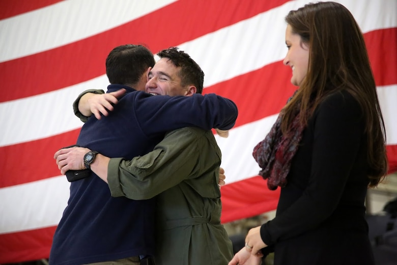 Capt. Brian Neri is welcomed by his family during a homecoming at Marine Corps Air Station Cherry Point, N.C., Dec. 19, 2016. A detachment of Marines from Marine Attack Squadron 542, Marine Aircraft Group 14, 2nd Marine Aircraft Wing, were attached to Marine Medium Tiltrotor Squadron 264 (Reinforced), Marine Aircraft Group 26, 2nd MAW, 22nd Marine Expeditionary Unit. The 22nd MEU, deployed with the Wasp Amphibious Ready Group, conducted naval operations in support of U.S. national security interests in Europe. Neri is an AV-8B Harrier II pilot assigned to VMA-542.  (U.S. Marine Corps photo by Sgt. N.W. Huertas/ Released)