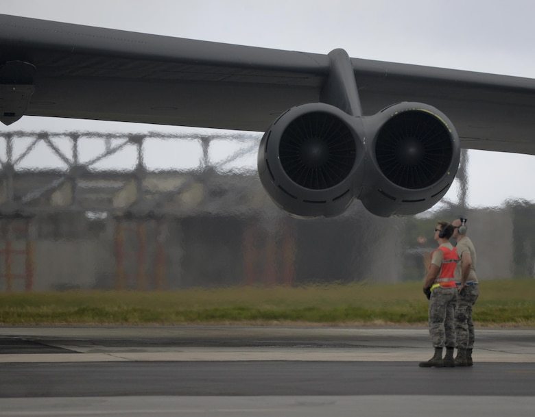 U.S. Airmen deployed from Minot Air Force Base, North Dakota, inspect a B-52 Stratofortress engine during takeoff preparations on Andersen Air Force Base, Guam, Dec. 17, 2016. U.S. Air Force bombers deploy routinely to support ongoing operations in the  Indo-Asia-Pacific region.  (U.S. Air Force photo by Staff Sgt. Benjamin Gonsier/Released)