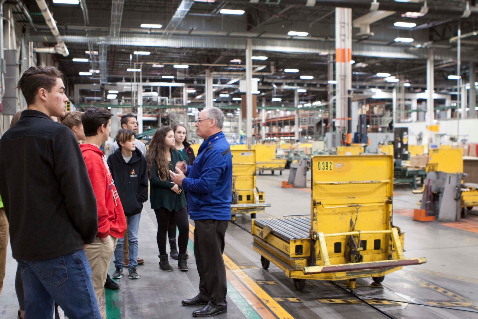 Students from Central York High School tour the Eastern Distribution Center at DLA Distribution Susquehanna, Pa., with employee Ron Hunziker.