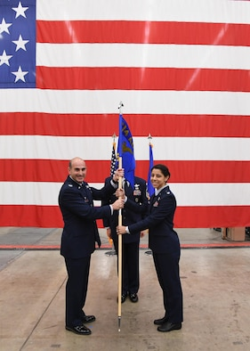 Col. Michael Manor, commander, 614th Air Operations Center and Joint Space Operations Center Director, passes the guidon to Lt. Col. Nicole Petrucci, commander, 614th Combat Training Squadron, during an activation ceremony Dec. 16, 2016 at Vandenberg Air Force Base, California.  As a new squadron under the 614th AOC, the 614th CTS will provide advanced training enabling the implementation and sustainment of Space Training Transformation and Space Mission Force initiatives and constructs across the unit. (U.S. Air Force photo by Capt. Nicholas Mercurio/Released)