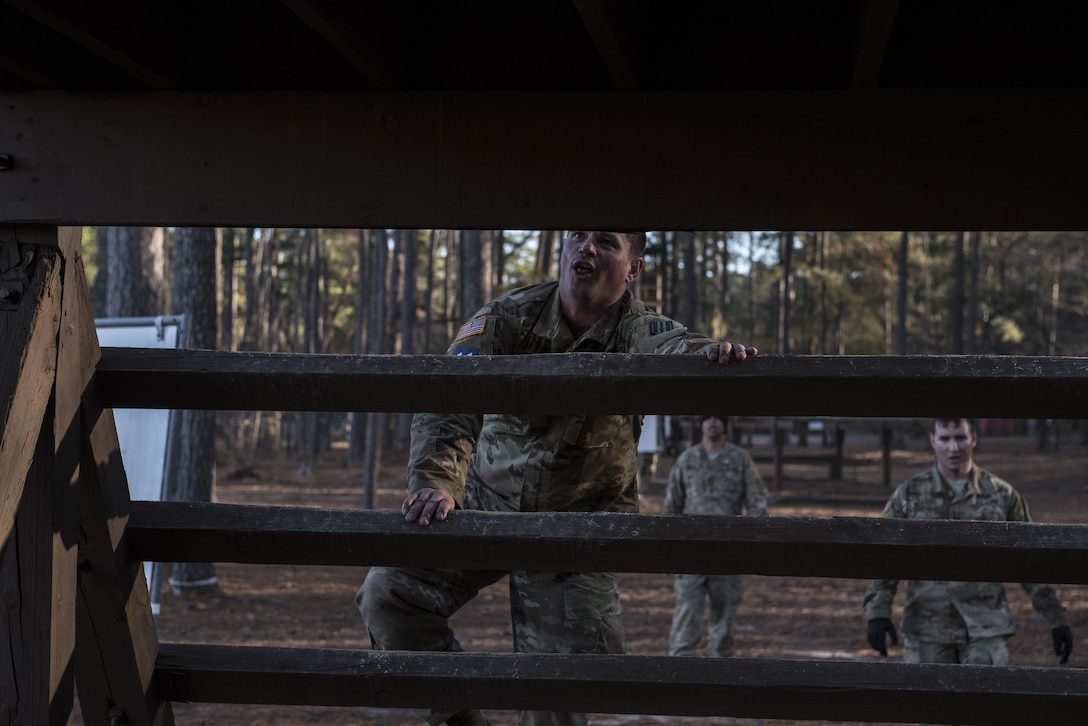 Soldiers participating in the Rubicon Command Team Challenge with the 193rd Infantry Brigade at Fort Jackson, S.C., tackle the night crawler obstacle, Dec. 9. The Rubicon Command Team Challenge was designed to exercise the leadership and combat skills for the company command teams within the 193rd Infantry Brigade, while at the same time building esprit de corps among the different teams. The challenge was held Dec. 8-9, 2016 at Fort Jackson, S.C.  (U.S. Army Reserve photo by Sgt. 1st Class Brian Hamilton/ released)