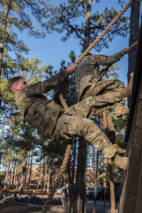 Soldiers participating in the Rubicon Command Team Challenge with the 193rd Infantry Brigade at Fort Jackson, S.C., tackle the wall hanger obstacle, Dec. 9. The Rubicon Command Team Challenge was designed to exercise the leadership and combat skills for the company command teams within the 193rd Infantry Brigade, while at the same time building esprit de corps among the different teams. The challenge was held Dec. 8-9, 2016 at Fort Jackson, S.C.  (U.S. Army Reserve photo by Sgt. 1st Class Brian Hamilton/ released)