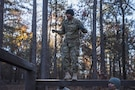 First Sgt. Lori Bost, Company D, Reception Holding Unit, 120th Adjutant General Battalion,  attempts to complete the tarzan obstacle at the confidence course on the second day of events during the Rubicon Command Team Challenge, Dec. 9. The Rubicon Command Team Challenge was designed to exercise the leadership and combat skills for the company command teams within the 193rd Infantry Brigade, while at the same time building esprit de corps among the different teams. The challenge was held Dec. 8-9, 2016 at Fort Jackson, S.C. (U.S. Army Reserve photo by Sgt. 1st Class Brian Hamilton/ released)