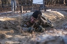First Sgt. Aaron Bullard, Company A, 3rd Battalion, 60th Infantry Regiment, attempts to complete the belly crawl obstacle during the Rubicon Command Team Challenge, Dec. 9. The Rubicon Command Team Challenge was designed to exercise the leadership and combat skills for the company command teams within the 193rd Infantry Brigade, while at the same time building esprit de corps among the different teams. The challenge was held Dec. 8-9, 2016 at Fort Jackson, S.C. (U.S. Army Reserve photo by Sgt. 1st Class Brian Hamilton/ released)