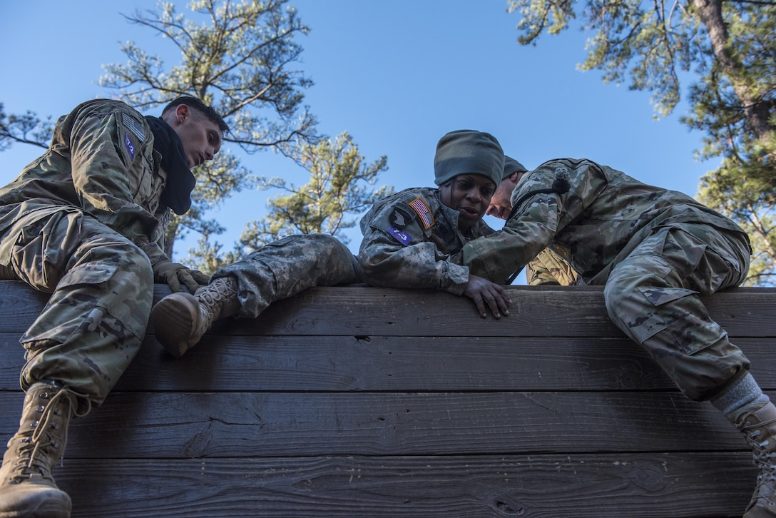 Soldiers participating in the Rubicon Command Team Challenge with the 193rd Infantry Brigade at Fort Jackson, S.C., tackle the 5-walls obstacle on the confidence course, Dec. 9. The Rubicon Command Team Challenge was designed to exercise the leadership and combat skills for the company command teams within the 193rd Infantry Brigade, while at the same time building esprit de corps among the different teams. The challenge was held Dec. 8-9, 2016 at Fort Jackson, S.C.  (U.S. Army Reserve photo by Sgt. 1st Class Brian Hamilton/ released)