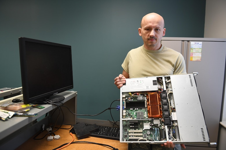 Brian Barnes, IT systems specialist with the 911th Communications Squadron, explains the new purpose of a server from an old mission at the Pittsburgh International Airport Air Reserve Station, Pennsylvania, Nov. 4, 2016. The 911th CS is currently working on repurposing this server to act as the server for future cyber operations training programs. (U.S. Air Force photo by Senior Airman Beth Kobily)