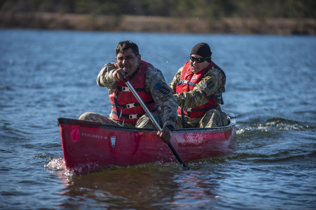 Soldiers participating in the Rubicon Command Team Challenge with the 193rd Infantry Brigade at Fort Jackson, S.C., paddle their canoe 400 meters across Weston Lake, Dec. 9. During the boat crossing challenge, participants had to get every member of their four Soldier teams across the lake, two Soldiers at a time. The Rubicon Command Team Challenge was designed to exercise the leadership and combat skills for the company command teams within the 193rd Infantry Brigade, while at the same time building esprit de corps among the different teams. The challenge was held Dec. 8-9, 2016 at Fort Jackson, S.C.  (U.S. Army Reserve photo by Sgt. 1st Class Brian Hamilton/ released)