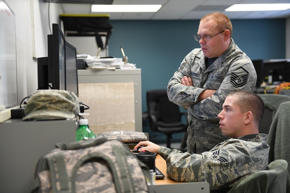 Master Sgt. Doug Obeldobel and Tech. Sgt. Andrew Wilson, client systems work center supervisor with the 911th Communications Squadron, participate in Cyber Tepper, a cyber exercise hosted by Carnegie Mellon University, at the Pittsburgh International Airport Air Reserve Station, Pennsylvania, Nov. 4, 2016. This exercise was a collaborative effort between Maj. Geoffrey Dobson, officer in charge of cyber assurance with the 911th CS, who works for the CERT division of the Software Engineering Institute at CMU, and Jerro Guo, PhD student with the Tepper School of Business. (U.S. Air Force photo by Senior Airman Beth Kobily)