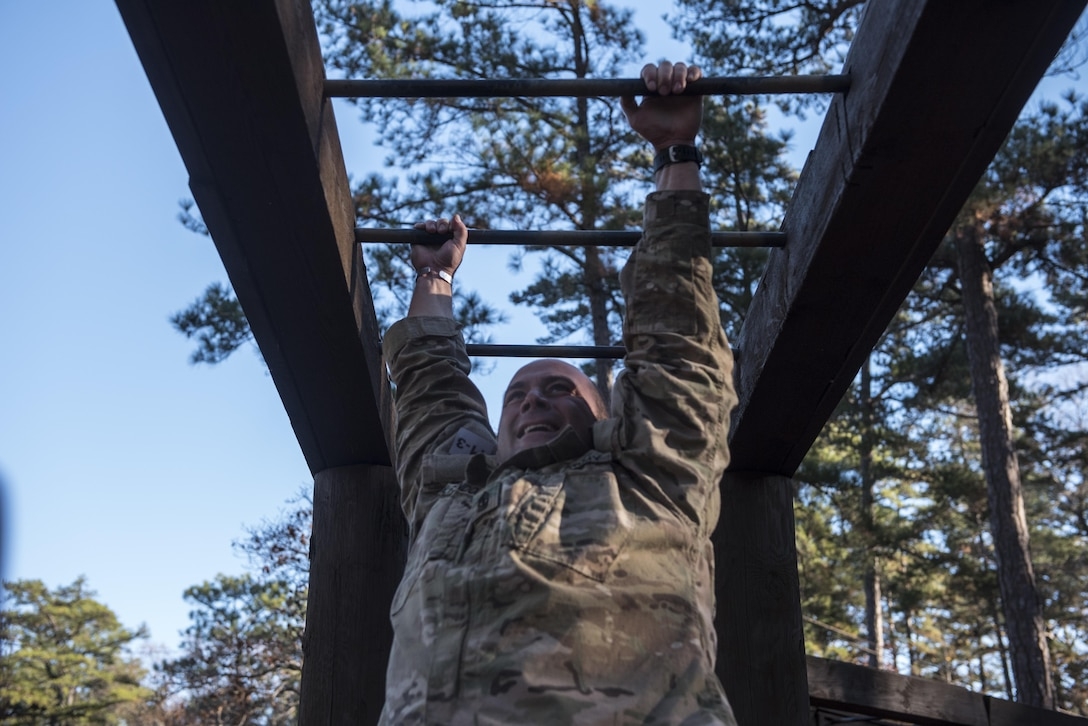 A Soldier participating in the Rubicon Command Team Challenge with the 193rd Infantry Brigade at Fort Jackson, S.C., attempts to complete the tarzan obstacle while at the confidence course, Dec. 9. The Rubicon Command Team Challenge was designed to exercise the leadership and combat skills for the company command teams within the 193rd Infantry Brigade, while at the same time building esprit de corps among the different teams. The challenge was held Dec. 8-9, 2016 at Fort Jackson, S.C. (U.S. Army Reserve photo by Sgt. 1st Class Brian Hamilton/ released)