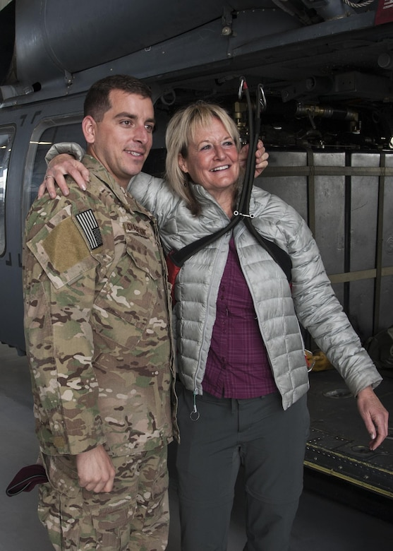 Ronda Ramsier poses with Tech Sgt. Matthew Champagne, U.S. Air Force Pararescue School instructor, in the harness used to rescue her after she became stranded during an August hike near Durango, Colorado. More than 50 Airmen assisted in the 12 hour search-and-rescue mission.