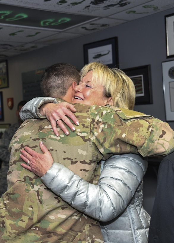 Ronda Ramsier hugs Tech Sgt. Matthew Champagne, U.S. Air Force Pararescue School instructor, at the 58th Special Operations Wing on Kirtland Air Force Base, N.M., Dec. 12. Champagne served as one of the Airmen who assisted in the search-and-rescue mission near Durango, Colorado, early August, when Ramsier became lost while hiking.