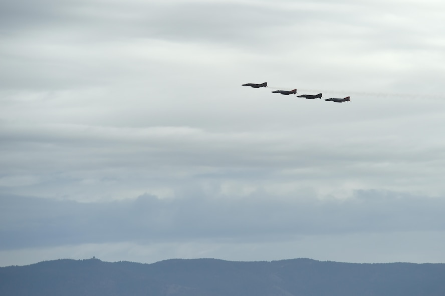 A QF-4 Phantom Four Ship formation flies over Holloman Air Force, Base, N.M., during the Phinal Phlight event on Dec. 21, 2016. This event marks the end of the aircraft's 53 years of service to the Air Force. (U.S. Air Force photo by Staff Sgt. Eboni Prince)