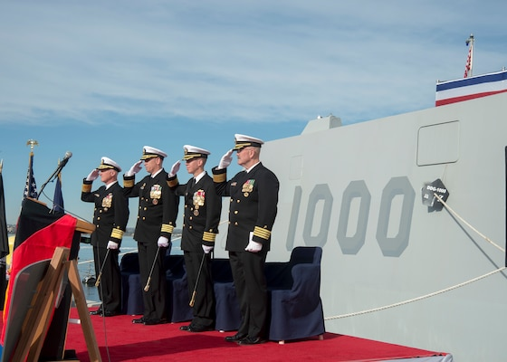 SAN DIEGO (Dec. 20, 2016) Left to right, Vice Adm. Thomas Rowden, commander, Naval Surface Forces, Capt. James A. Kirk, outgoing commanding officer (CO) of  guided-missile destroyer USS Zumwalt (DDG 1000), Capt. Scott A. Tait, in-coming CO of Zumwalt, and Capt. W. Kyle Fauntleroy, Force Chaplain, Surface Force, U.S. Pacific Fleet, salute the ensign during a change of command ceremony at Naval Base San Diego. (U.S. Navy photo by Petty Officer 2nd Class Zachary Bell/Released)