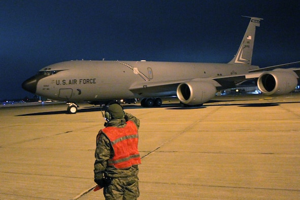 A crew chief salutes as a KC-135 Stratotanker departs Selfridge Air National Guard Base for a deployment to Southwest Asia. Approximately 100 Airmen from Selfridge left on the deployment on the evening of Dec. 12. The Airmen will be deployed overseas through the holiday season and into early 2017. (U.S. Air National Guard photo by Tech. Sgt. Dan Heaton)