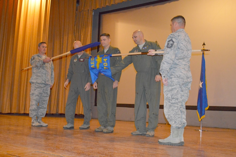 AEDC Commander Col. Rodney Todaro, center, observes while Col. Andrew L. Allen, (fourth from right), the 704th Test Group commander reveals the 704th Test Group guidon during a re-designation ceremony Dec. 6 at Holloman Air Force Base, New Mexico. The Test Group was previously the 96th Test Group under the 96th Test Wing, Eglin AFB, Florida. Also pictured left to right is flag bearer Master Sgt. Marc Berger, 96th Test Wing Commander Brig. Gen. Christopher Azzano and flag bearer Senior Master Sgt. Ian Hall. (U.S. Air Force photo/Tech. Sgt. Dejaye Herrera)