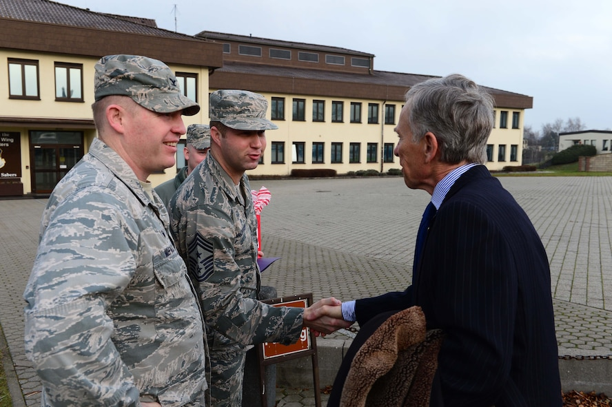 David McKean, right, U.S. Ambassador to Luxembourg, is greeted by Col. Joe McFall, left, 52nd Fighter Wing commander, and Chief Master Sgt. Edwin Ludwigsen, middle, 52nd FW command chief, outisde the wing headquarters building after arriving at Spangdahlem Air Base, Germany, Dec. 20, 2016. This was McKean's first visit to the base as he was briefed by leadership about the Saber Nation mission and different capabilities of the base during his tour. McKean was sworn in as Ambassaor in March 2016. (U.S. Air Force photo by Senior Airman Joshua R. M. Dewberry)