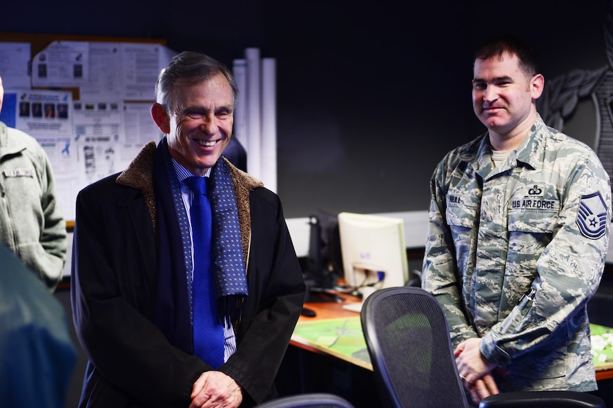 David McKean, left, U.S. Ambassador to Luxembourg, is briefed by Master Sgt. Gerald Null, right, 52nd Operations Support Squadron air traffic control watch supervisor, in the air traffic control tower on Spangdahlem Air Base, Germany, Dec. 20, 2016. This was McKean's first visit to the base as he was briefed by leadership about the Saber Nation mission and different capabilities of the base during his tour. McKean was sworn in as Ambassaor in March 2016. (U.S. Air Force photo by Senior Airman Joshua R. M. Dewberry)